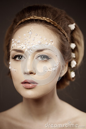 Woman with creative make-up of pearls