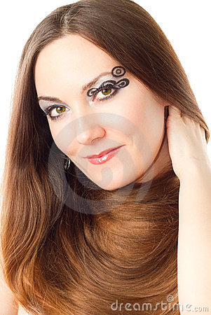 Woman with creative makeup, bodyart and long hair