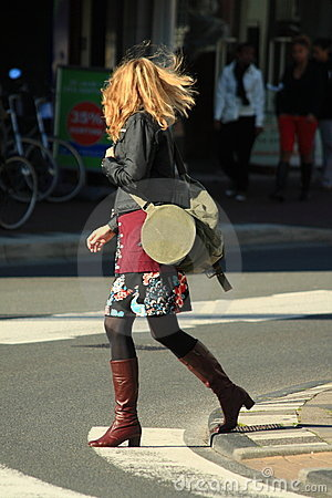 Woman crossing the street Editorial Photo