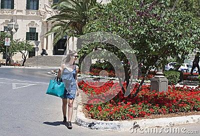 Woman crossing street in Malta