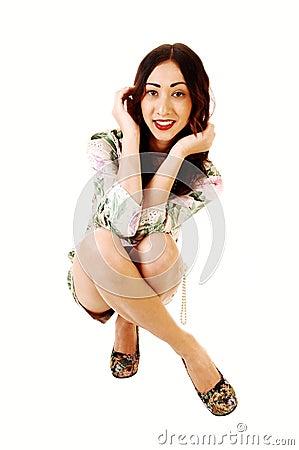 Woman crouching on floor.