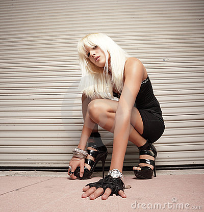 Woman crouching on the ground