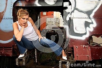 Woman crouching inside truck