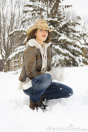 Woman crouching in snow
