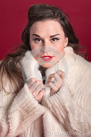 Woman Cuddles in Fur Coat
