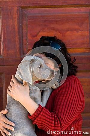 Woman cuddling pet dog