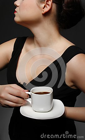 Woman with a cup of black coffee