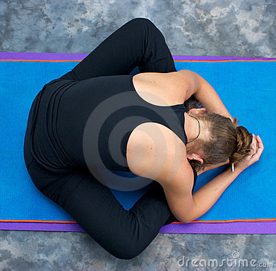 woman curled up in bound angle forward fold