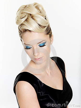 Stock Photography: Woman with curly hairstyle and blue make-up