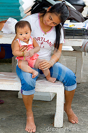 Woman with cute baby in Thailand Editorial Image