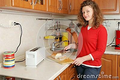 Woman cutting bread