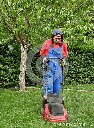 Woman cutting the grass
