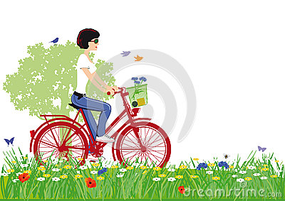 Woman cycling in countryside