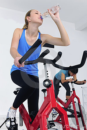 Woman cycling at the gym