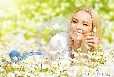 Woman on daisy field