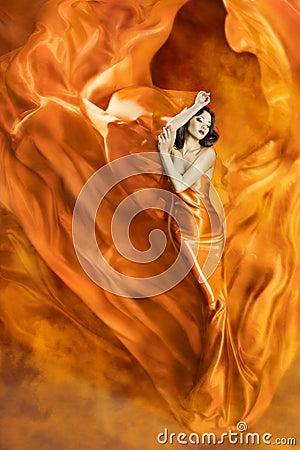 Free Woman Dance Fire, Fashion Girl Orange Dress Dancing Fabric Stock Photo - 62685220