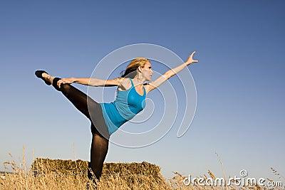 Woman in Dance Pose in a Field