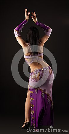 Woman dance in traditional arabian costume - back