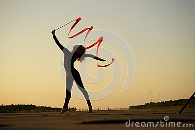 Woman dancer posing with ribbon