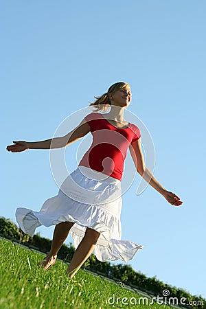 Woman dancing on grass