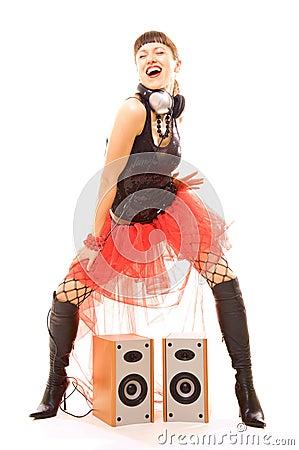 Woman dancing near speakers with pleasure