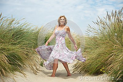 woman dancing sand beach portrait beautiful middle aged 33035833