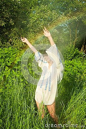Woman dancing in summer rain