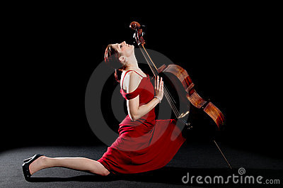 Woman dancing the tango with a cello