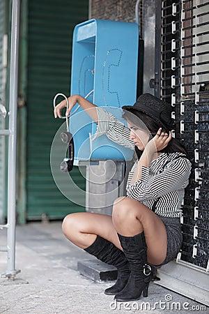 Woman dangling the phone