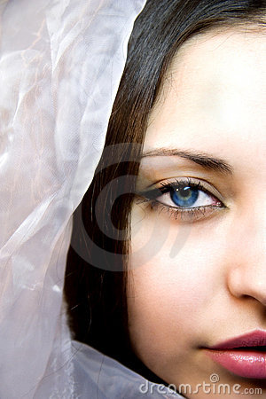Woman with dark blue eyes in a silk scarf