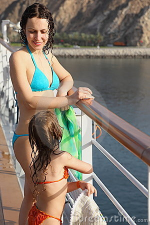 Woman with daughter both wearing swimming suit