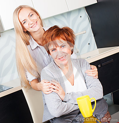 Woman with daughter on kitchen