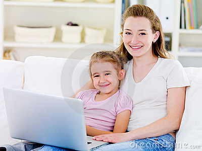 Woman with daughter with laptop