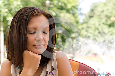 Woman daydreaming in peaceful garden