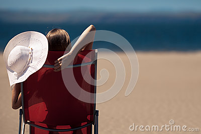 Woman on a deckchair at the beach