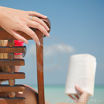 Woman in deckchair Reading