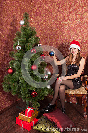 Woman decorate a christmas tree
