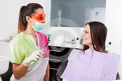 Woman dentist talking to her patient