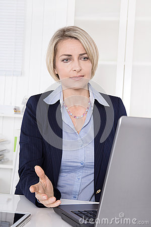 Woman at desk has problems with computer.