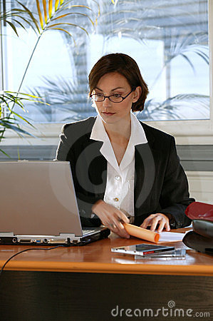 Woman at desk with laptop computer