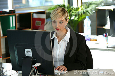 Woman at desk using computer