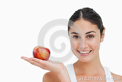 Woman on diet with an apple in the hand