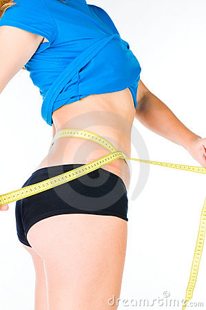 Woman diet concept with measuring tape