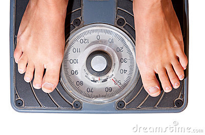 Woman on diet. Scale isolated