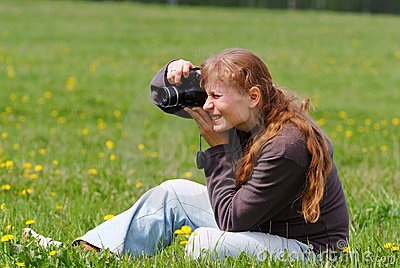 Woman with digital camera. Outdoors.
