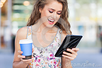 Woman with digital tablet and coffee