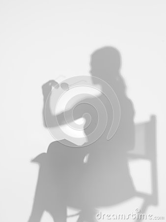 Woman on director s chair, silhouette