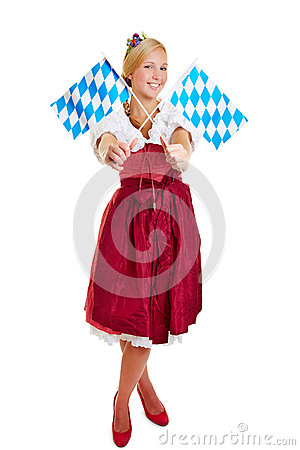 Woman in dirndl with bavarian flags