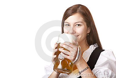 Woman in dirndl cloth holds Oktoberfest beer stein