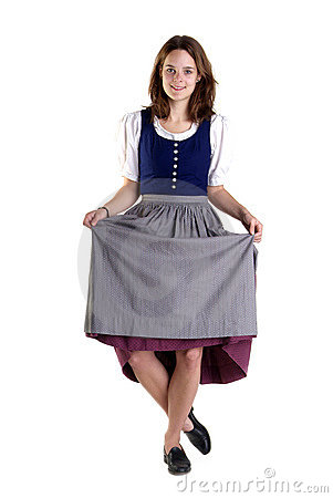 Woman in Dirndl drops a curtsey